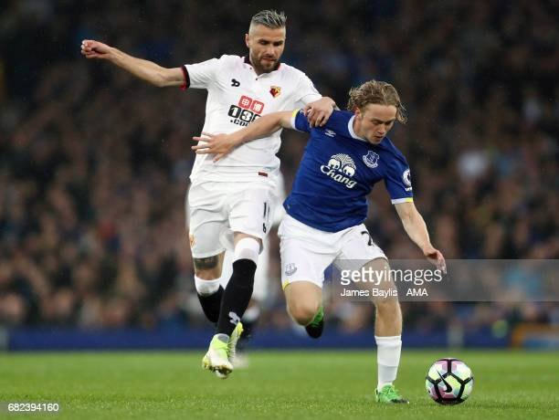Valon Behrami of Watford and Tom Davies of Everton during the Premier League match between Everton and Watford at Goodison Park on May 12 2017 in...
