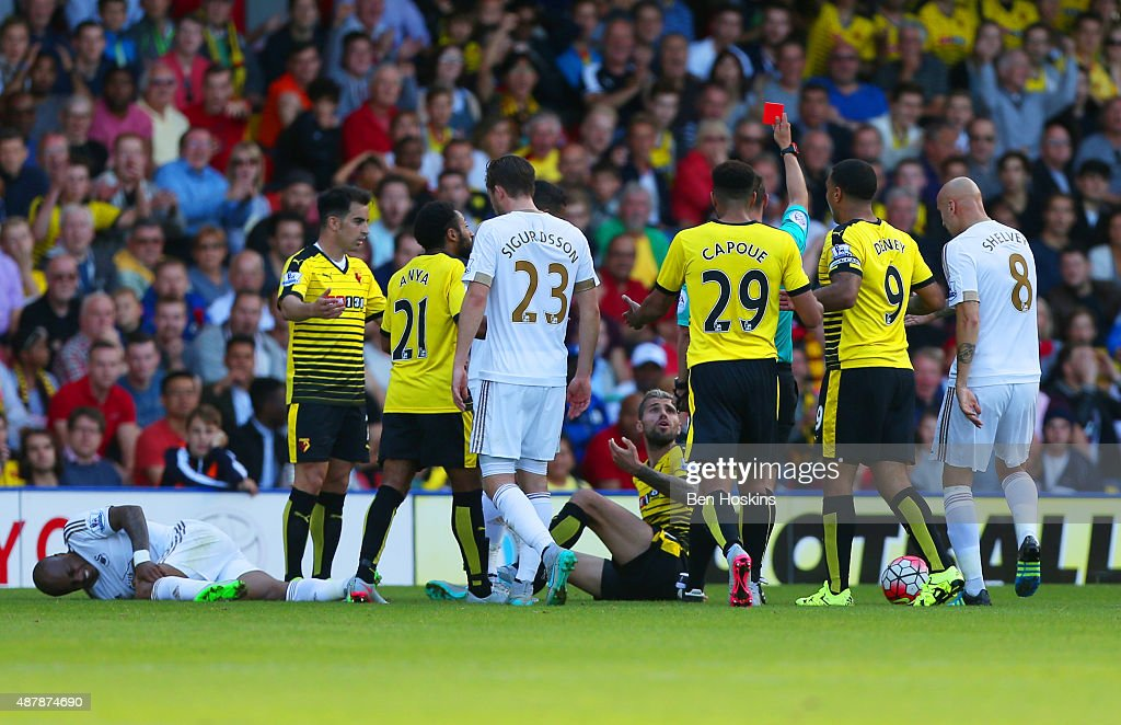 <a gi-track='captionPersonalityLinkClicked' href=/galleries/search?phrase=Valon+Behrami&family=editorial&specificpeople=453450 ng-click='$event.stopPropagation()'>Valon Behrami</a> of Watford is shown the red card by referee Robert Madley during the Barclays Premier League match between Watford and Swansea City at Vicarage Road on September 12, 2015 in Watford, United Kingdom.