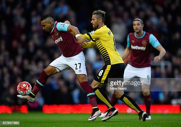 Valon Berami of Watford puts pressure on Dimitri Payet of West Ham United during the Barclays Premier League match between West Ham United and...