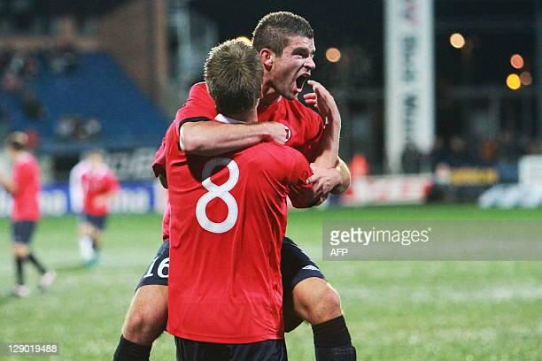 Valon Berisha of Norway celebrates after scoring against England during the U21 European Championship qualifying match at the Marienlyst stadium in...
