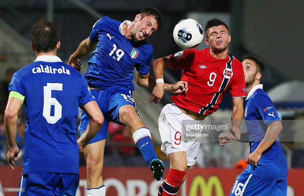 Valon Berisha (2R) of Norway is challenged by Luca Caldirola, Vasco Regini and Andrea Bertolacci (L-R) of Italy during the UEFA European U21 Championship Group A match between Norway and Italy at Bloomfield Stadium on June 11, 2013 in Tel Aviv, Israel.