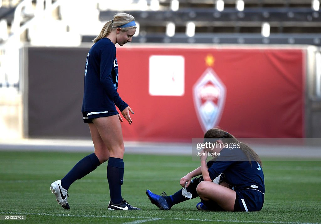 Valor Christian Eagles d, mf Paige Kula (9) walks over to console teammate Valor Christian Eagles mf, forw Brianna Johnson (19) after their loss to Lewis-Palmer Rangers 1-0 for the 4A state soccer championship title May 25, 2016 at Dicks Sporting Goods Park.