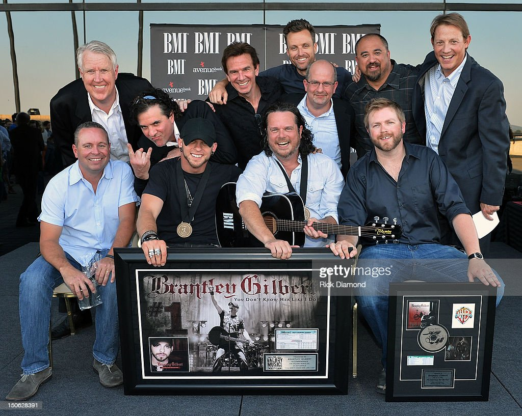 Valory Music's George Briner, Big Machine Label Group's Scott Borchetta, producer Dann Huff, Hard 8 Management's Rich Egan, Avenue Bank's Ron Cox, Hard 8 Management's Steve Tusman, and BMI's Clay Bradley; front row (l-r): Warner-Tamerlane Publishing's Steve Markland, Brantley Gilbert, co-writer Jim McCormick, and Warner-Tamerlane Publishing's BJ Hillattend attend BMI #1 Party For Singer/Co-Writer Brantley Gilbert and Co-Writer Jim McCormick for 'You Don't Know Her Like I Do' At BMI Nashville on August 22, 2012 in Nashville, Tennessee.