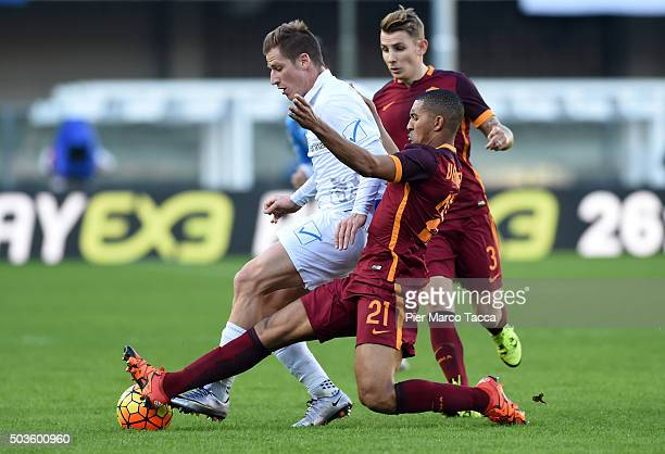 Valter Birsa of AC Chievo competes for the ball with William Falque of AS Romaduring the Serie A match between AC Chievo Verona and AS Roma at Stadio...