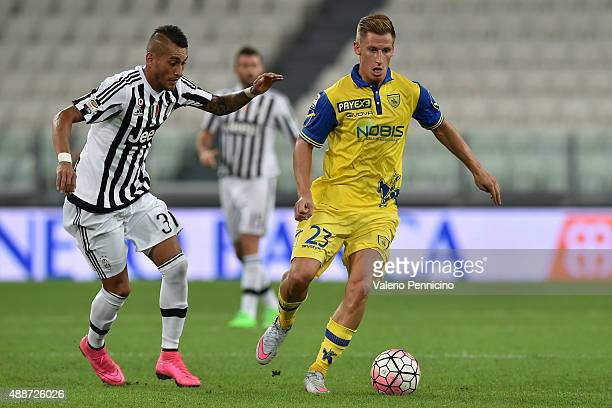 Valter Birsa of AC Chievo Verona is challenged by Roberto Maximilian Pereyra of Juventus FC during the Serie A match between Juventus FC and AC...