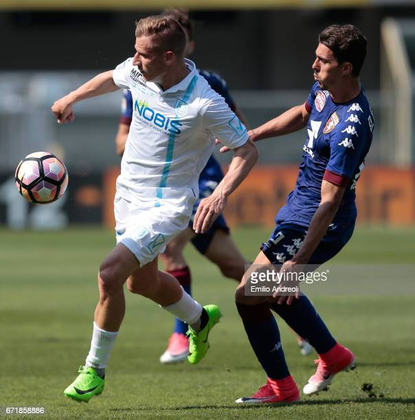 Valter Birsa of AC ChievoVerona competes for the ball with Danilo Avelar of Torino FC during the Serie A match between AC ChievoVerona and FC Torino...