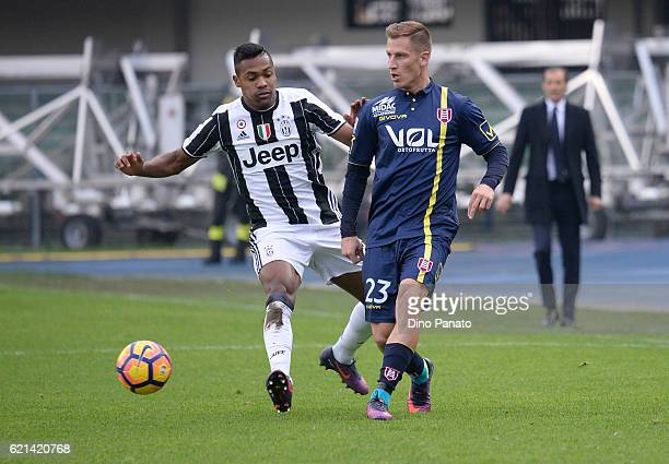 Valter Birsa of AC ChievoVerona competes with Alex Sandro of Juventus FC during the Serie A match between AC ChievoVerona and Juventus FC at Stadio...