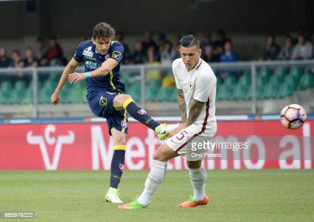 Valter Birsa of AC ChievoVerona competes with Leandro Paredesof AS Roma during the Serie A match between AC ChievoVerona and AS Roma at Stadio...