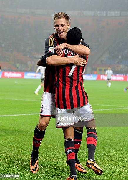 Valter Birsa of AC Milan celebrates scoring the first goal during the Serie A match between AC Milan and Udinese Calcio at Giuseppe Meazza Stadium on...