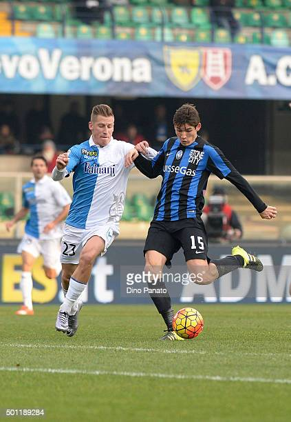 Valter Birsa of Chievo Verona competes with Marten De Roon of Atalanta BC during the Serie A match between AC Chievo Verona and Atalanta BC at Stadio...