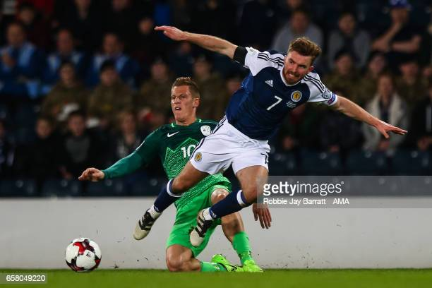 Valter Birsa of Slovenia and James Morrison of Scotland during the FIFA 2018 World Cup Qualifier between Scotland and Slovenia at Hampden Park on...