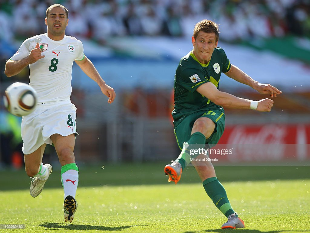 Valter Birsa (l) of Slovenia shoots as Medhi Lacen (l) looks on during the 2010 FIFA World Cup South Africa Group C match between Algeria and Slovenia at the Peter Mokaba Stadium on June 13, 2010 in Polokwane, South Africa.