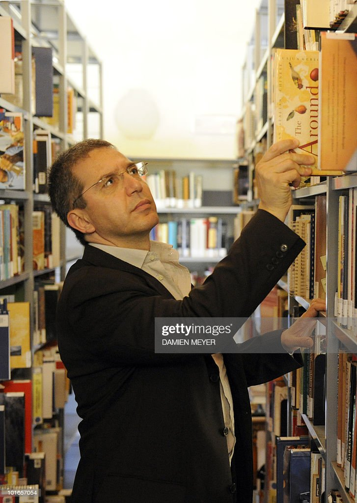 GORSE. Valter Cantino, director of the Gastronomic Science University poses in the university Library in Bra (40km south of Turin), amidst 12 000 books ranging from cooking, agriculture, agronomy to dieting, on May 31, 2010. Established in 2004, this university based on 'Slowfood' concepts against standardization of taste and for respectful environment gastronomy, forms gastronoms, but not chiefs.
