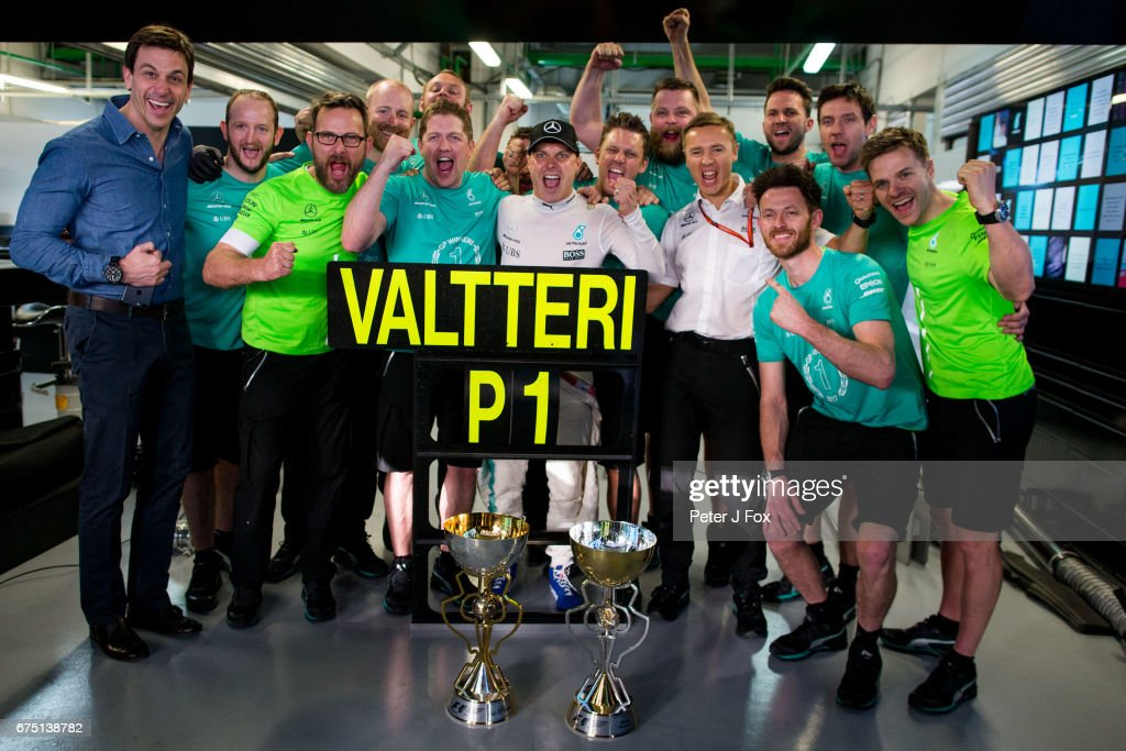 Valterri Bottas of Mercedes and Finland celebrates with his team and Toto Wolff of Mercedes and Germany during the Formula One Grand Prix of Russia on April 30, 2017 in Sochi, Russia.