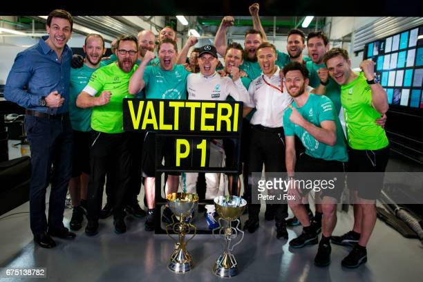 Valterri Bottas of Mercedes and Finland celebrates with his team and Toto Wolff of Mercedes and Germany during the Formula One Grand Prix of Russia...