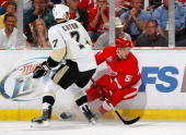 Valterri Flippula of the Detroit Red Wings skates in front of the defense of Mark Eaton of the Pittsburgh Penguins during Game Five of the 2009...