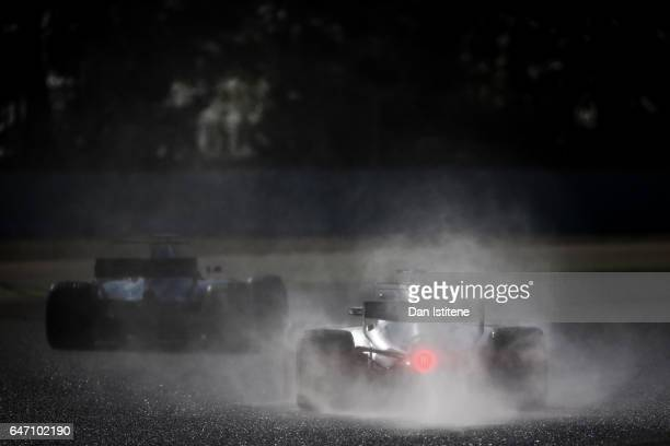 Valtteri Bottas drives the Mercedes AMG Petronas F1 Team Mercedes F1 WO8 ahead of Stoffel Vandoorne of Belgium in the McLaren Honda Formula 1 Team...