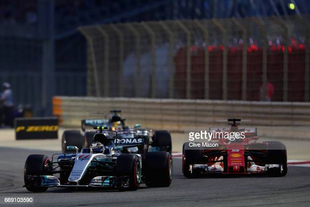 Valtteri Bottas driving the Mercedes AMG Petronas F1 Team Mercedes F1 WO8 leads Sebastian Vettel of Germany driving the Scuderia Ferrari SF70H and...