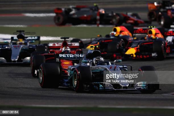 Valtteri Bottas driving the Mercedes AMG Petronas F1 Team Mercedes F1 WO8 leads Sebastian Vettel of Germany driving the Scuderia Ferrari SF70H and...