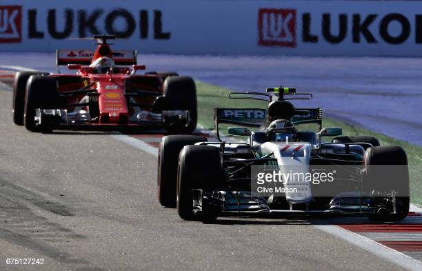 Valtteri Bottas driving the Mercedes AMG Petronas F1 Team Mercedes F1 WO8 leads Sebastian Vettel of Germany driving the Scuderia Ferrari SF70H on...