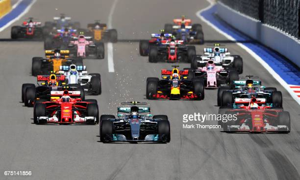 Valtteri Bottas driving the Mercedes AMG Petronas F1 Team Mercedes F1 WO8 leads the field into turn 2 at the start during the Formula One Grand Prix...