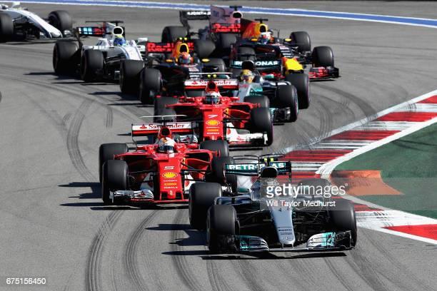 Valtteri Bottas driving the Mercedes AMG Petronas F1 Team Mercedes F1 WO8 leads Sebastian Vettel of Germany driving the Scuderia Ferrari SF70H Kimi...