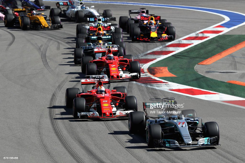Valtteri Bottas driving the (77) Mercedes AMG Petronas F1 Team Mercedes F1 WO8 leads Sebastian Vettel of Germany driving the (5) Scuderia Ferrari SF70H Kimi Raikkonen of Finland driving the (7) Scuderia Ferrari SF70H and the rest of the field at the start during the Formula One Grand Prix of Russia on April 30, 2017 in Sochi, Russia.