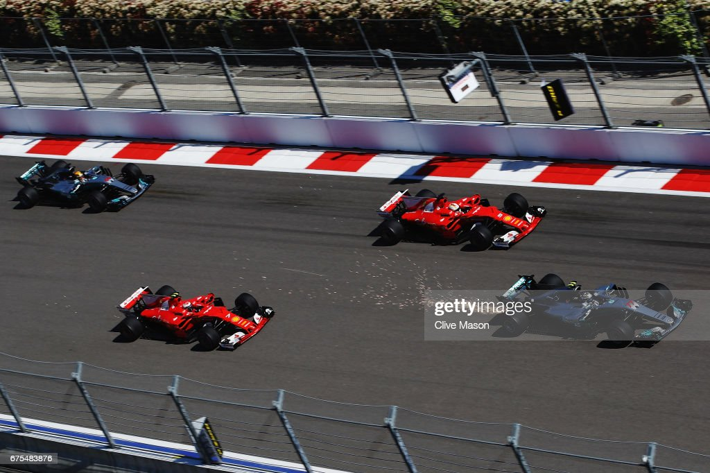 Valtteri Bottas driving the (77) Mercedes AMG Petronas F1 Team Mercedes F1 WO8 leads Sebastian Vettel of Germany driving the (5) Scuderia Ferrari SF70H, Kimi Raikkonen of Finland driving the (7) Scuderia Ferrari SF70H and Lewis Hamilton of Great Britain driving the (44) Mercedes AMG Petronas F1 Team Mercedes F1 WO8 into turn 2 at the start during the Formula One Grand Prix of Russia on April 30, 2017 in Sochi, Russia.