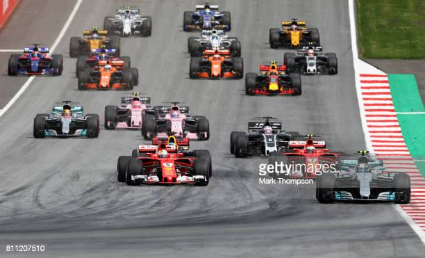 Valtteri Bottas driving the Mercedes AMG Petronas F1 Team Mercedes F1 WO8 leads the field including Max Verstappen of Netherlands and Red Bull Racing...
