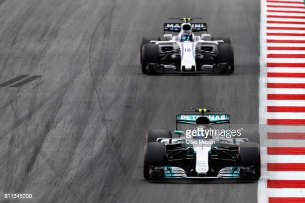 Valtteri Bottas driving the Mercedes AMG Petronas F1 Team Mercedes F1 WO8 leads Lance Stroll of Canada driving the Williams Martini Racing Williams...