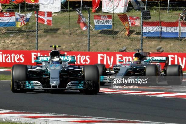 HUNGARORING BUDAPEST HUNGARY Valtteri Bottas driving the Mercedes AMG Petronas F1 Team Mercedes F1 WO8 leads Lewis Hamilton of Great Britain driving...