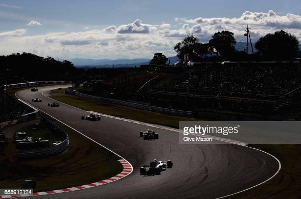 Valtteri Bottas driving the Mercedes AMG Petronas F1 Team Mercedes F1 WO8 follows Daniel Ricciardo of Australia driving the Red Bull Racing Red...