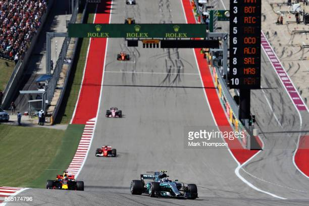 Valtteri Bottas driving the Mercedes AMG Petronas F1 Team Mercedes F1 WO8 leads Daniel Ricciardo of Australia driving the Red Bull Racing Red BullTAG...