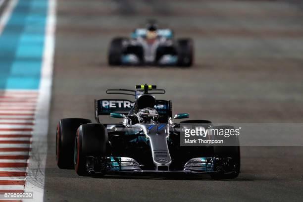 Valtteri Bottas driving the Mercedes AMG Petronas F1 Team Mercedes F1 WO8 leads Lewis Hamilton of Great Britain driving the Mercedes AMG Petronas F1...