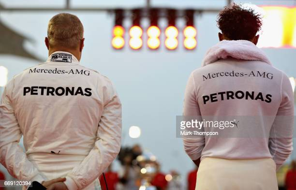 Valtteri Bottas of Finland and Mercedes GP and Lewis Hamilton of Great Britain and Mercedes GP on the grid before the Bahrain Formula One Grand Prix...