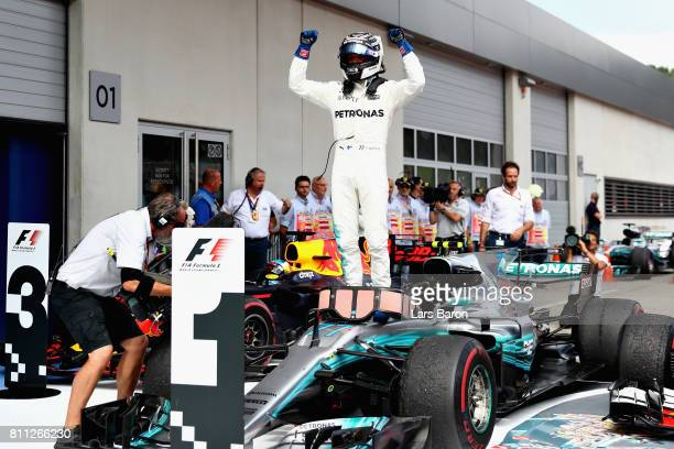 Valtteri Bottas of Finland and Mercedes GP celebrates his win in parc ferme during the Formula One Grand Prix of Austria at Red Bull Ring on July 9...