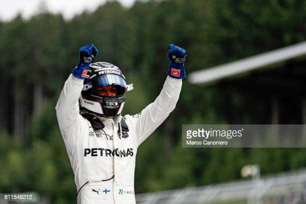 Valtteri Bottas of Finland and Mercedes GP celebrates his win in parc ferme during the Formula One Grand Prix of Austria