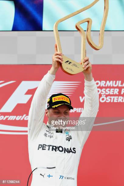 Valtteri Bottas of Finland and Mercedes GP celebrates his win on the podium during the Formula One Grand Prix of Austria at Red Bull Ring on July 9...