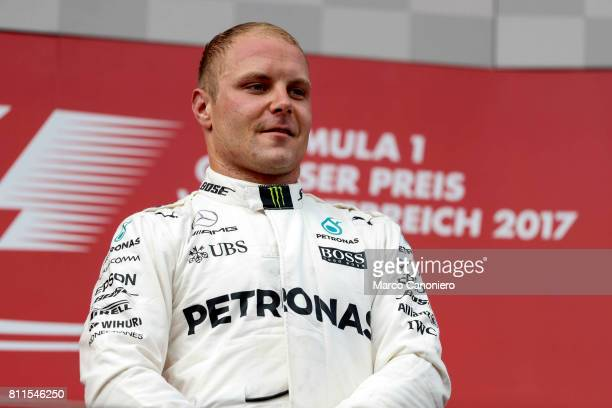 Valtteri Bottas of Finland and Mercedes GP celebrates his win on the podium during the Formula One Grand Prix of Austria