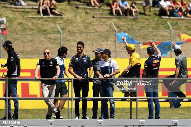 Valtteri Bottas of Finland and Mercedes GP Daniel Ricciardo of Australia and Red Bull Racing and Felipe Massa of Brazil and Williams on the drivers...