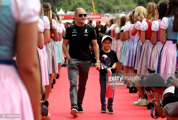 Valtteri Bottas of Finland and Mercedes GP on the drivers parade before the Formula One Grand Prix of Austria at Red Bull Ring on July 9 2017 in...
