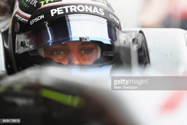Valtteri Bottas of Finland and Mercedes GP sits in his car in the garage during day two of Formula One winter testing at Circuit de Catalunya on...