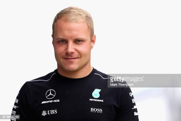 Valtteri Bottas of Finland and Mercedes GP walks in the Paddock during previews ahead of the Formula One Grand Prix of Great Britain at Silverstone...