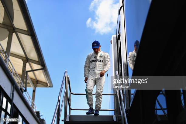 Valtteri Bottas of Finland and Mercedes GP walks to the garage before practice for the Formula One Grand Prix of Hungary at Hungaroring on July 28...