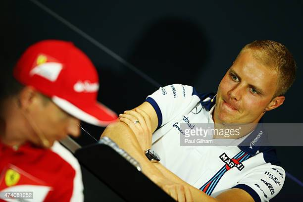 Valtteri Bottas of Finland and Williams and Kimi Raikkonen of Finland and Ferrari attend the drivers press conference during previews to the Monaco...