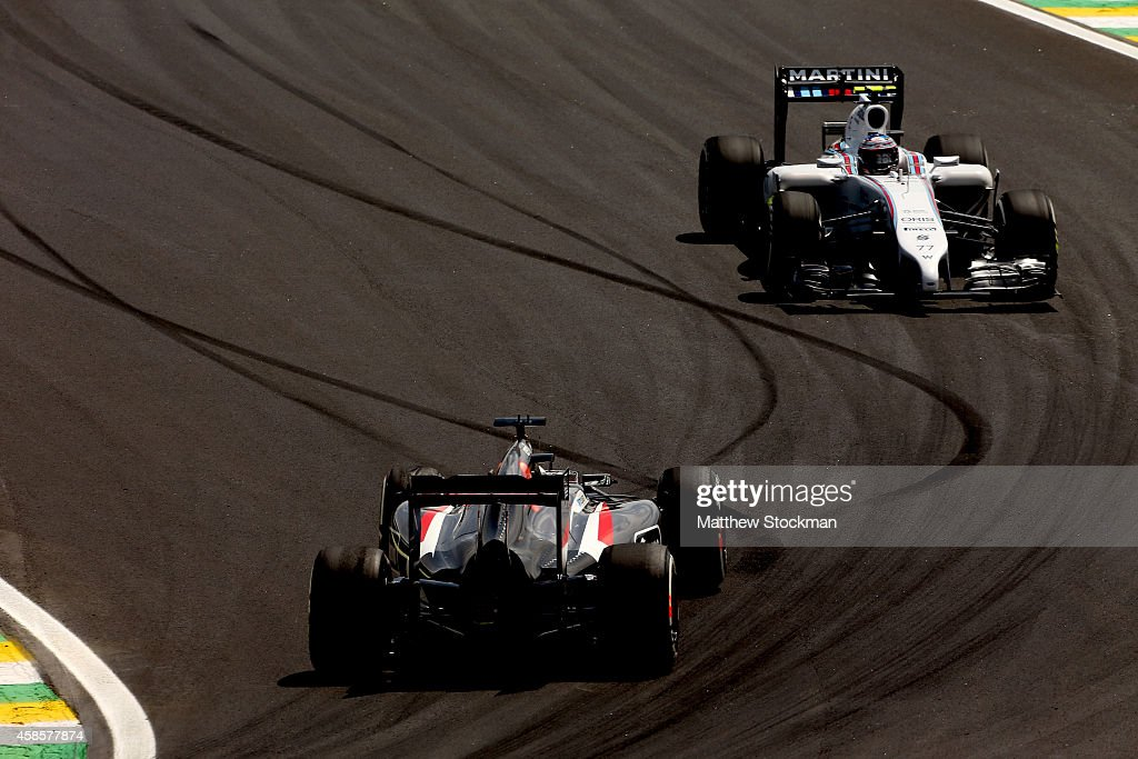 <a gi-track='captionPersonalityLinkClicked' href=/galleries/search?phrase=Valtteri+Bottas&family=editorial&specificpeople=8640136 ng-click='$event.stopPropagation()'>Valtteri Bottas</a> of Finland and Williams approaches <a gi-track='captionPersonalityLinkClicked' href=/galleries/search?phrase=Adrian+Sutil&family=editorial&specificpeople=750787 ng-click='$event.stopPropagation()'>Adrian Sutil</a> of Germany and Sauber F1 during practice ahead of the Brazilian Formula One Grand Prix at Autodromo Jose Carlos Pace on November 7, 2014 in Sao Paulo, Brazil.