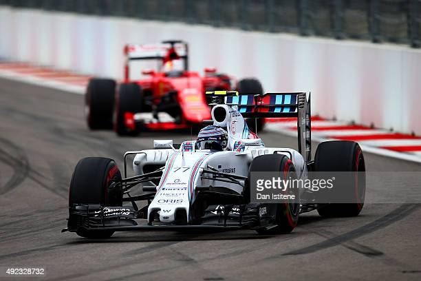 Valtteri Bottas of Finland and Williams drives ahead of Sebastian Vettel of Germany and Ferrari during the Formula One Grand Prix of Russia at Sochi...