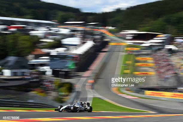 Valtteri Bottas of Finland and Williams drives around Eau Rouge during the Belgium Grand Prix at Circuit de SpaFrancorchamps on August 24 2014 in Spa...