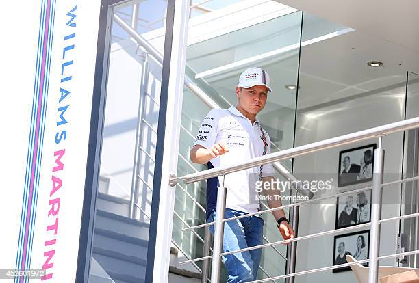 Valtteri Bottas of Finland and Williams looks on from the team hospitality unit in the paddock during previews ahead of the Hungarian Formula One...