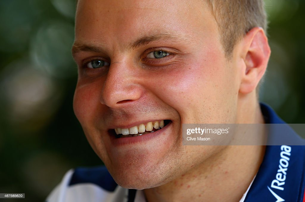 <a gi-track='captionPersonalityLinkClicked' href=/galleries/search?phrase=Valtteri+Bottas&family=editorial&specificpeople=8640136 ng-click='$event.stopPropagation()'>Valtteri Bottas</a> of Finland and Williams smiles as he speaks with members of the media in the paddock during previews to the Malaysia Formula One Grand Prix at Sepang Circuit on March 26, 2015 in Kuala Lumpur, Malaysia.